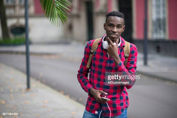 portrait of smiling african teenager - nigerian men stock photos and pictures