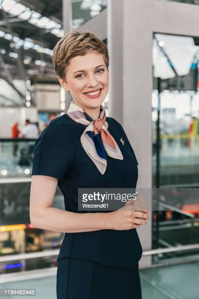 portrait of smiling airline employee at the airport - crew stock pictures, royalty-free photos & images