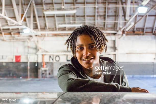 portrait of smiling androgynous mixed race woman - black transgender stock pictures, royalty-free photos & images