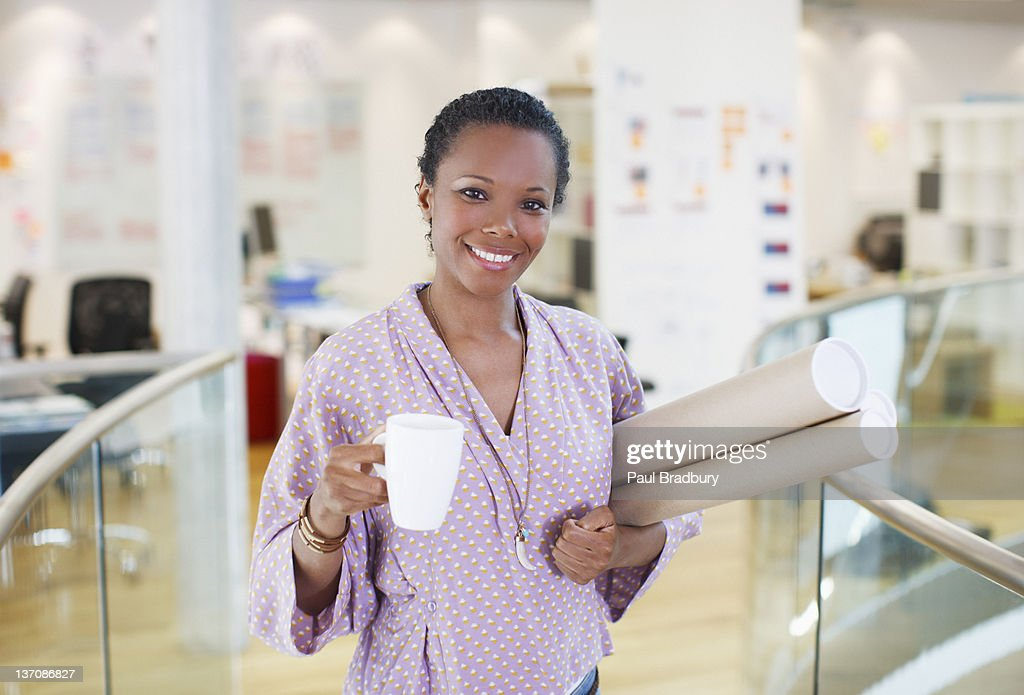 Portrait of smiling architect with tea and blueprint tubes in office portrait of smiling architect with tea and blueprint tubes in office stock photo malvernweather Image collections