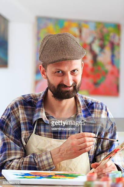 Portrait of smiling artist in his workshop
