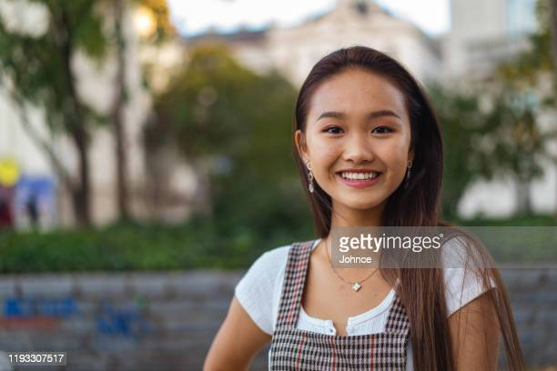 portrait of smiling asian girl - medium shot stock pictures, royalty-free photos & images
