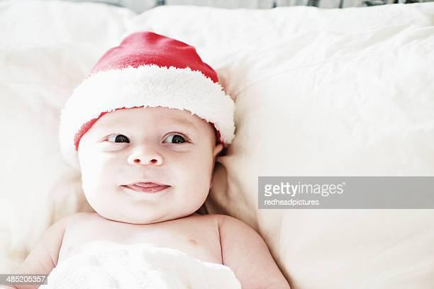 Portrait of smiling baby boy in santa hat