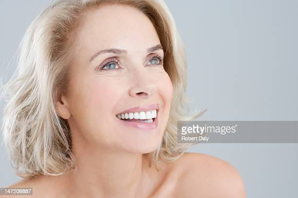 Portrait of smiling bare chested woman
