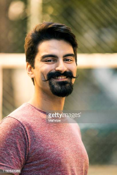 portrait of smiling bearded hipster guy - goatee stock pictures, royalty-free photos & images