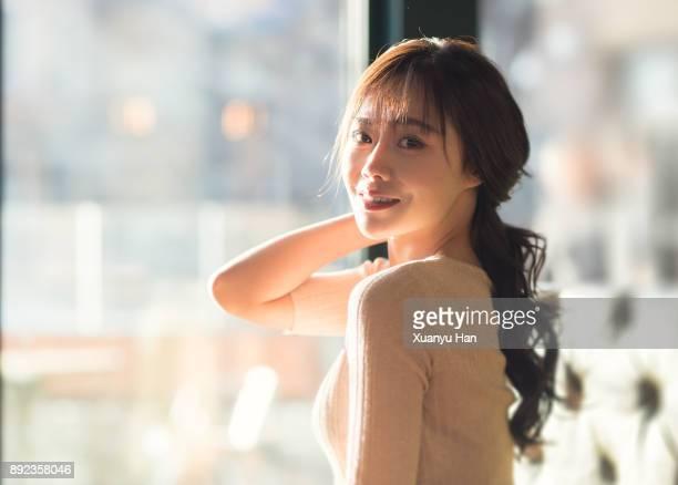 portrait of smiling beautiful woman - ポニーテール ストックフォトと画像