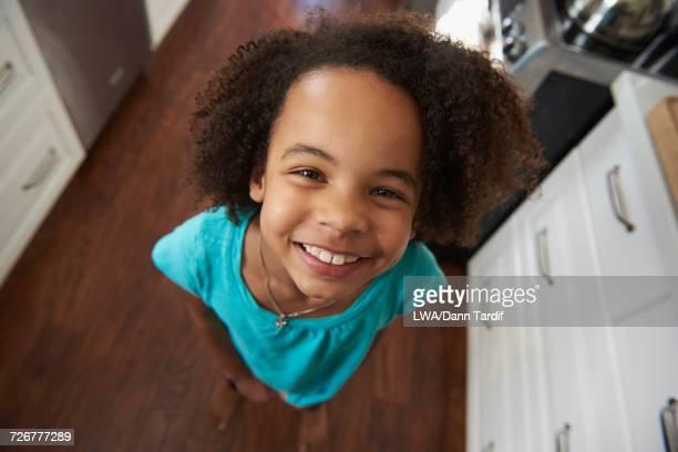 Portrait of smiling Black girl in domestic kitchen