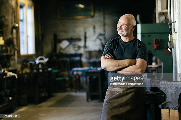 portrait of smiling blacksmith - craftsman stock photos and pictures