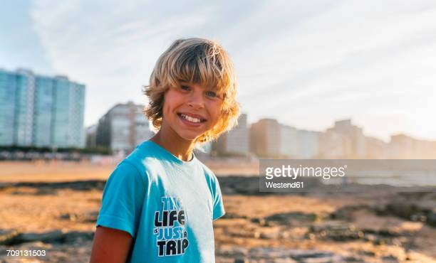 Portrait of smiling blond on the beach at sunset
