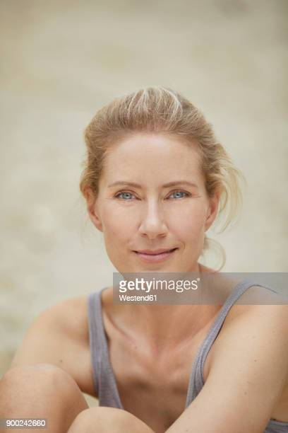 Portrait of smiling blond woman on the beach