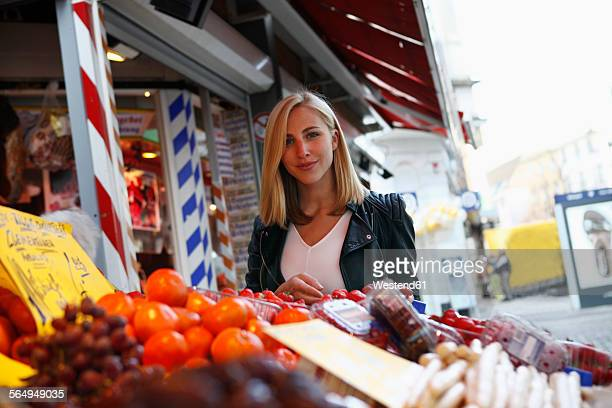 Portrait of smiling blond woman on weekly market