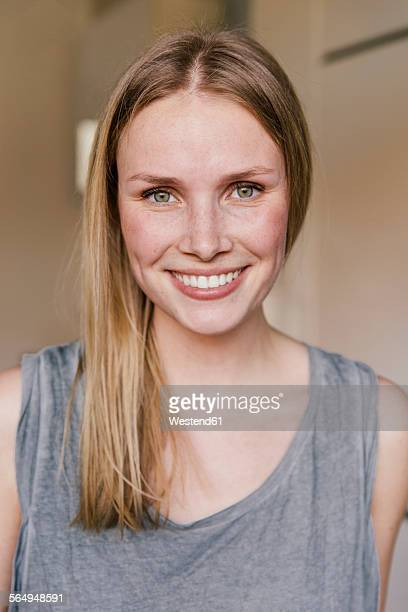 portrait of smiling blond woman - ピンクの頬 ストックフォトと画像