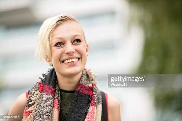 Portrait of smiling blonde woman with scarf