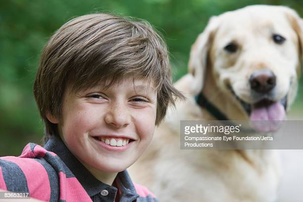 Portrait of smiling boy and his dog
