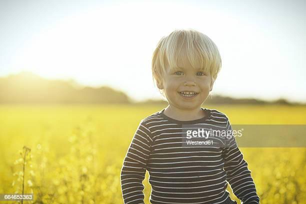 Portrait of smiling boy in canola field
