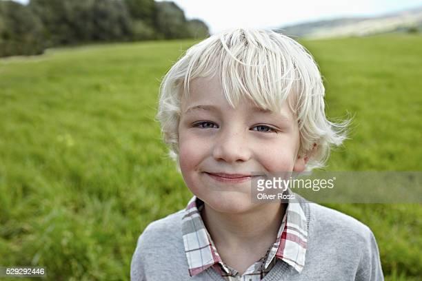 Portrait of smiling boy (5-6) in field