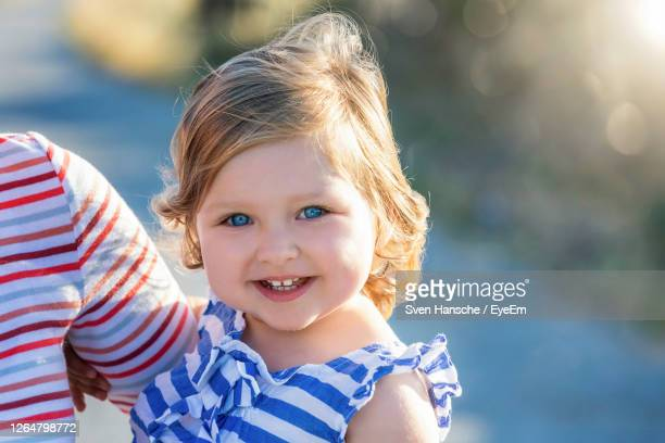 portrait of smiling boy - blue eyes stock pictures, royalty-free photos & images