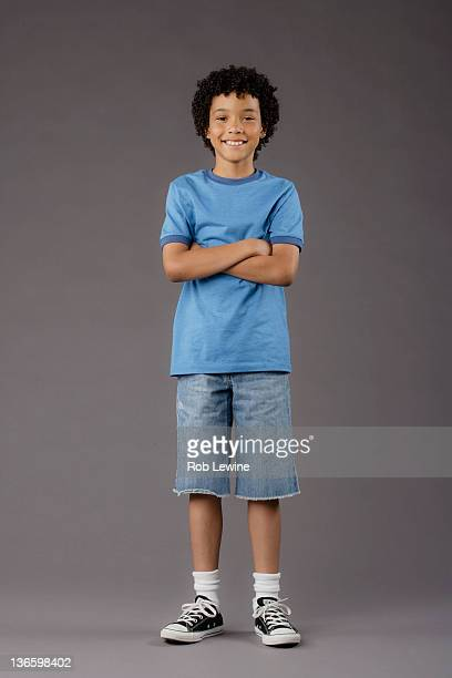 portrait of smiling boy (8-9), studio shot - black pants stock pictures, royalty-free photos & images