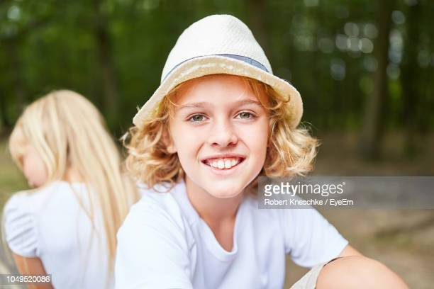 Portrait Of Smiling Boy Wearing Hat Outdoors