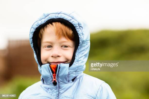 Portrait of smiling boy wearing hooded jacket