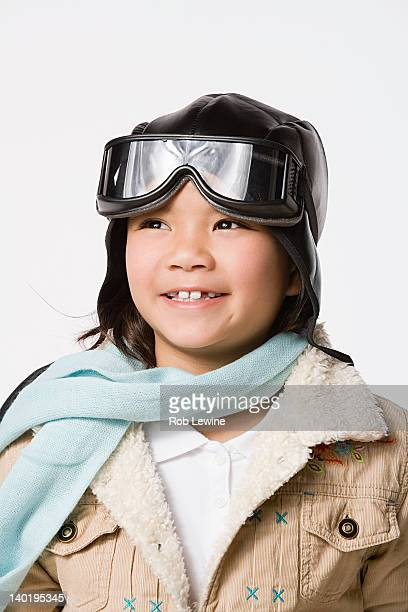 portrait of smiling boy (8-9) wearing pilot hat and jacket, studio shot - uniform cap stock pictures, royalty-free photos & images