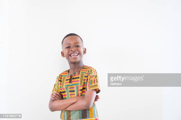 portrait of smiling boy with arms crossed - one boy only stock pictures, royalty-free photos & images