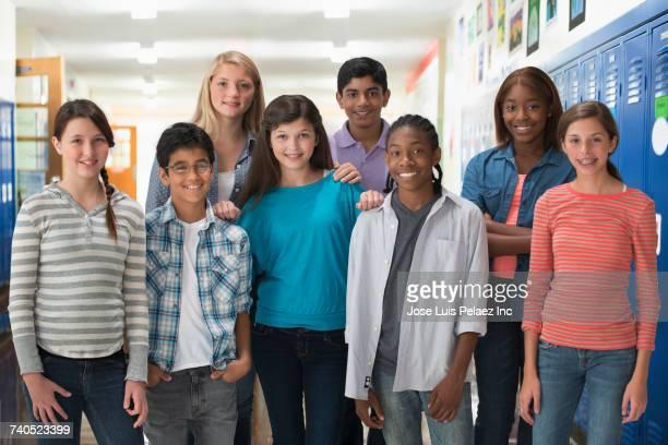 Portrait of smiling boys and girls in school corridor