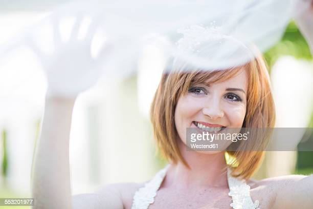 Portrait of smiling bride with veil