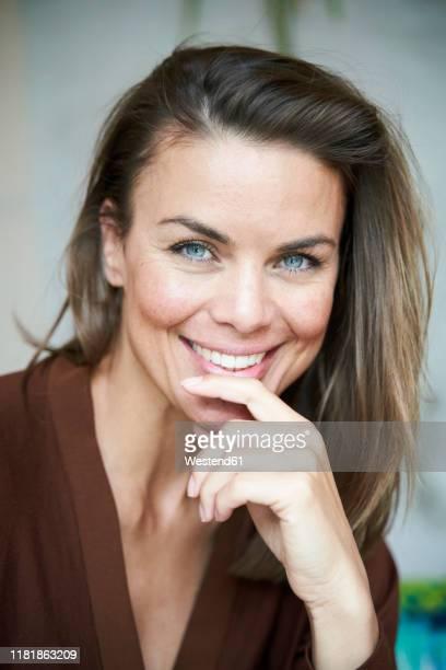 portrait of smiling brunette woman - one mature woman only stock-fotos und bilder