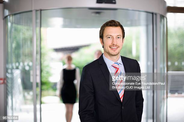 "portrait of smiling business man - ""compassionate eye"" stock pictures, royalty-free photos & images"