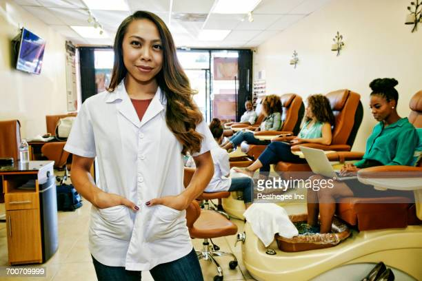 Portrait of smiling business owner in nail salon