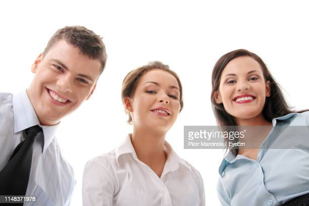 portrait of smiling business people against white background - フォーマルウェア ストックフォトと画像