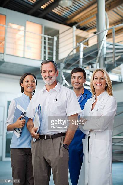 Portrait of smiling business people and scientist