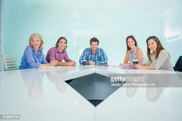 Portrait of smiling business people in modern conference room