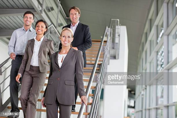 Portrait of smiling business people on stairs