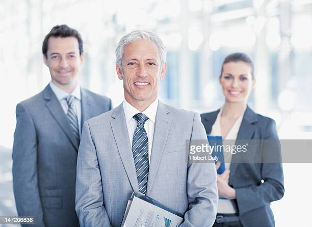 portrait of smiling business people - mid volwassen mannen stockfoto's en -beelden