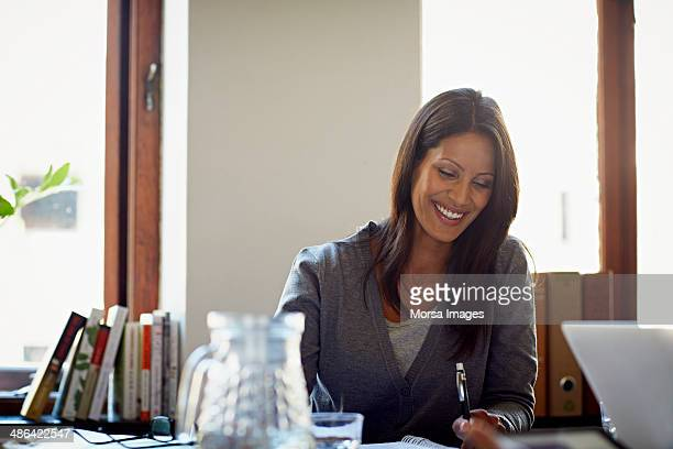 Portrait of smiling business woman during meeting