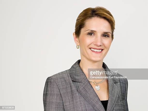 """portrait of smiling business woman - """"compassionate eye"""" stock pictures, royalty-free photos & images"""