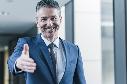 Portrait of smiling businessman about to shake hands - gettyimageskorea