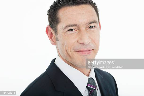 "portrait of smiling businessman, close up - ""compassionate eye"" stock pictures, royalty-free photos & images"