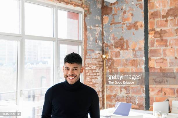 portrait of smiling businessman in creative office - smart casual stock pictures, royalty-free photos & images