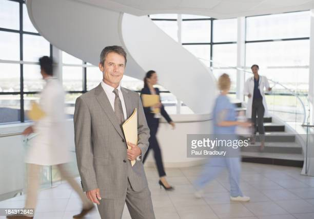 Portrait of smiling businessman in hospital