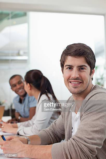 Portrait of smiling businessman in meeting