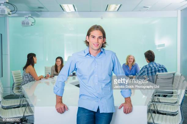 Portrait of smiling businessman in modern conference room