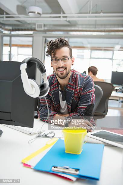 portrait of smiling businessman in office - half shaved hairstyle stock pictures, royalty-free photos & images