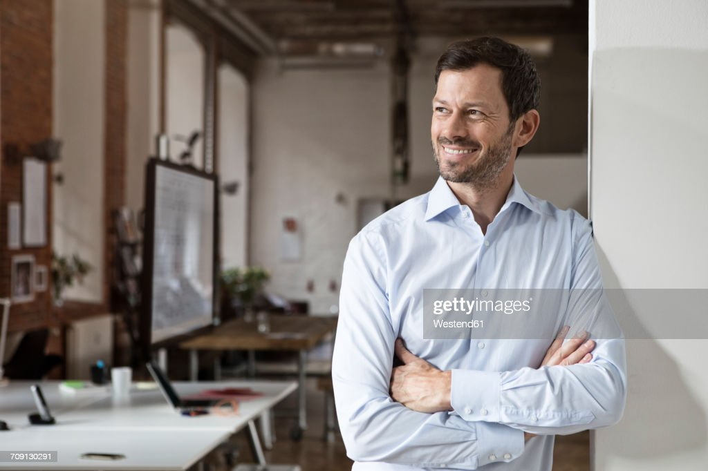 Portrait of smiling businessman in office : Stock-Foto