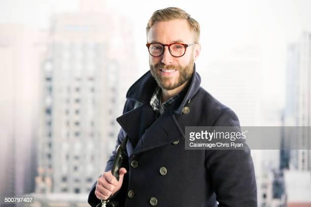 Portrait of smiling businessman in urban window