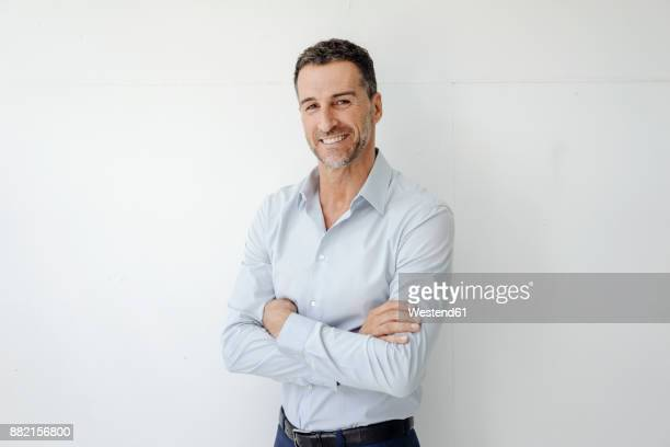 portrait of smiling businessman - waist up stock pictures, royalty-free photos & images
