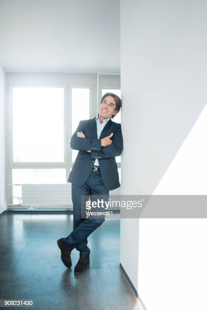 Portrait of smiling businessman standing on office floor