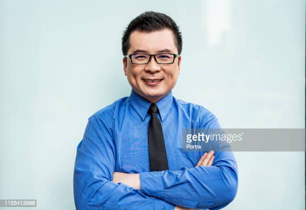 portrait of smiling businessman with arms crossed - shirt and tie stock pictures, royalty-free photos & images